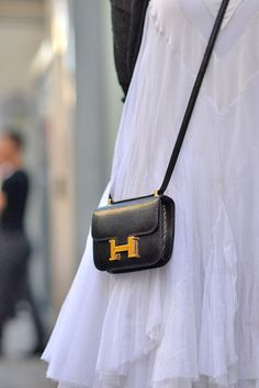 mini bags are all the rage (this one is Hermes)