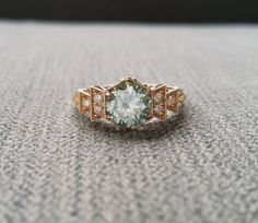 Hey, I found this really awesome Etsy listing at https://www.etsy.com/listing/448551744/antique-icy-blue-moissanite-and-diamond