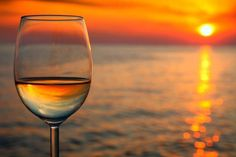 Wine glass reflection in the beach