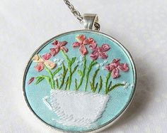 Ribbon embroidery tea cup necklace pink flowers on blue silk applique french knots.