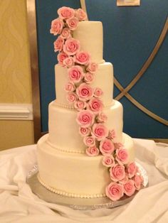 4 tier round wedding cake with cascading pink sugar roses.
