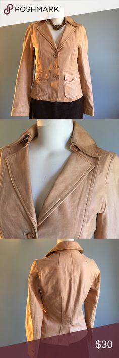 Tan Leather Jacket Lined with cotton, with minimal soiling, this cool jacket has wood buttons, front flap pocket detail. Nice lines. Bust 36\