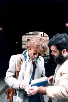 John Lennon giving an autograph the morning of December 8th, 1980