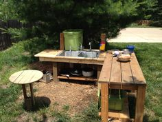 My kids outdoor mud kitchen. Complete with tub of topsoil and water barrel to make mud concoctions of their dreams. My girls ages 4, 5 and 6 love it, as do all the kids in the neighborhood. Easy to build with scrap lumber and second hand sinks.