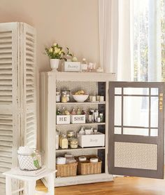 Oh to have this much room for bathroom storage - repurposed cupboard used for storage.