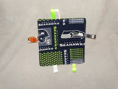 Hey, I found this really awesome Etsy listing at https://www.etsy.com/listing/218844854/tag-blanket-baby-shower-gift-seattle  #tagblanket #babyblanket #sensoryblanket #baby #babyshowergift #giftidea #seattle #seahawks #1fan #handsewn #homeade