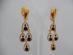 Visit: hipandcoolcliponearringstwo.com and receive up to 30% off. CLIP ON GOLD DANGLING BLACK STONE EARRINGS  $10.99 http://hipandcoolcliponearringstwo.com