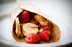 Breakfast Energy Wrap.  PB, banana, berries, sliced almonds, cinnamon, honey.  Yum.
