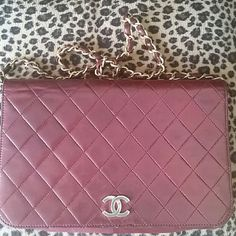 Chanel vintage burgundy purse Chanel authentic vintage purse.  It's burgundy and it's vintage because it has the eclair imprinted on the zipper. If you can see there is a small patch on the inside of the purse where the lock is. I had it repair because the lock had fallen off but they put that small patch and that's why I'm selling it lower. It's soft lambskin and the stitching is aligned well. I saw a purse similar here for 2000. I'm dropping my price to 1000 because of the patch. Its on…