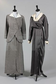 A directoire style tailored ladies' summer suit, circa 1911, labelled Au Bon Marche, A. Boucicaut, no 55383 TZ, of black and white ticking with pique collar, the jacket cut away at the front like a man's tailcoat with striped self covered buttons to fasten and three smaller ones at the raised waist level, A-line skirt with buttons down the back; together with a distressed grey satin day dress with narrow Doucet label