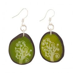 """Swirling trees, laser engraved on green dyed tagua nut slices, create your own """"Magic Forest."""" Also known as """"vegetable ivory,"""" tagua is produced by a palm-like tree in South America. The nuts fall to the ground when mature, thus harve Dichroic Glass Jewelry, Fair Trade Jewelry, Magic Forest, Beautiful Earrings, Handcrafted Jewelry, Women's Earrings, Jewelry Crafts, Gifts, Consumerism"""