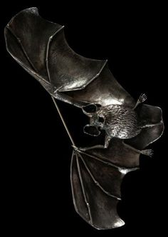 An Art Nouveau 'Bat' brooch, ca.1900, France, oxidised cast silver and stone. #ArtNouveau #bat #brooch