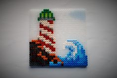 hama perler beads - A lighthouse and a wave by: Nina V. Kristensen