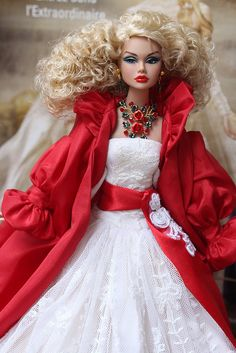 This doll is currently the center of attention!!! She's modelling a beautiful gown by Gin-O. The red coat is from the Fashion Royalty Monogram Line, jewels by me. www.etsy.com/shop/IsabelleParisJewels