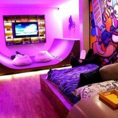 Sweet skateboard ramp in this teen boy bedroom