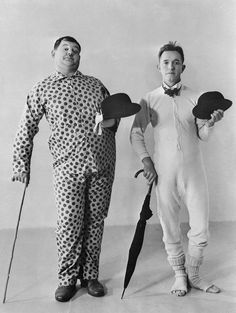 Stan Laurel - wears open-toed socks, long johns and a bow tie, while Oliver Hardy - on his right, has opted for a spotted pyjama outfit.