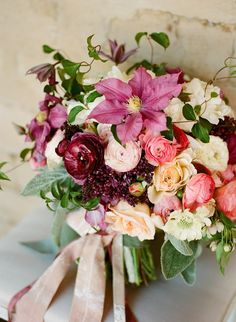Dierdre, I couldnt help thinking if you when I saw this bouquet. So romantic but different // Ranunculus, scabiosa, clematis bouquet by Twig & Twine