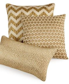 Add luxury and luster to your space with this Hotel Collection decorative pillow, featuring gold embroidery on a gold ground. | Shell: cotton/polyester; embroidery: polyester; polyester fill | Spot cl