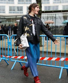 Hari Nef in a Loewe jacket and bag and Gucci shoes