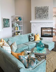 """L"" Shape Turquoise Design Lounge Area with orange + natural tone accessories Four Chairs Furniture + Cadence Homes"