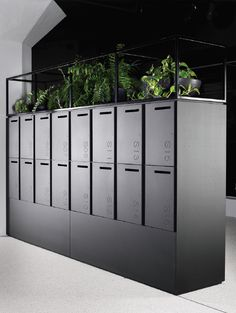 Raised lockers for better access - plants used to bring designs to life #industrialofficedesigns