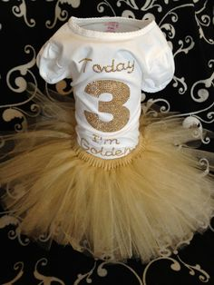 This golden birthday outfit can be done in any age and any size. U will get a handmade shirt and a handmade shimmer tulle tutu. Check out www.audrinascloset.etsy.com for customizable outfits, shirts and tutus.