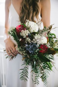 unstructured bridal bouquet with protea and thistle