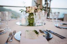 Wedding tablesetting, wedding day, on the terrace with sea view, flowers centerpiece, crystals and candels, Sposa Mediterranea, Olga Studio.