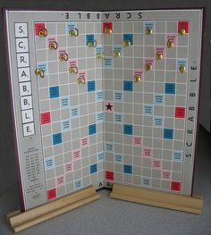 Board Game Necklace Display | Flickr - Photo Sharing!  I like this idea, i would wash or tea stain the broad so that it is a bit darker and does not take away from the jewelry  :).  But this would take very little room in the car on the way to and from shows.