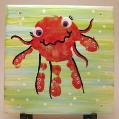 My neices handprint turned into an octopus, painted on a ceramic tile. My neices handprint turned into an octopus, painted on a ceramic tile. Ocean Crafts, Beach Crafts, Summer Crafts, Crafts To Do, Crafts For Kids, Daycare Crafts, Preschool Crafts, Daycare Rooms, Toddler Art