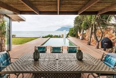 Entire home/apt in Cape Town, South Africa. Swim to the edge of the sparkling pool and take in the stunning ocean view. Lofty doors open up this luxurious villa, and the rock-lined fireplace adds a rustic feel. A romantic swing with plush cushions overlooks the sea and sunset.