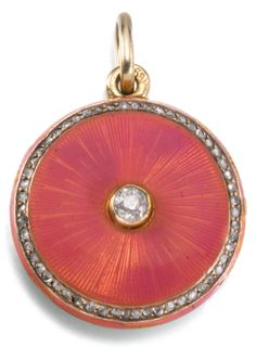 A Fabergé jewelled gold and enamel locket, workmaster August Holmström, St Petersburg, 1899-1903 | Sotheby's -circular, the face enamelled in translucent rose Pompadour over sunburst engine-turning within a border of rose-cut diamonds and centred with a circular-cut diamond, the interior with glazed aperture, struck with workmaster's initials, 56 standard, the scratched inventory number rubbed, possibly 7116 diameter 2.1cm, 7/8 in.