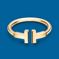 Be bold with a Tiffany T wire ring in 18k gold.