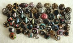 60 Vintage Antique Black Glass LUSTER PAINTED Buttons | eBay. Sold for $12.50