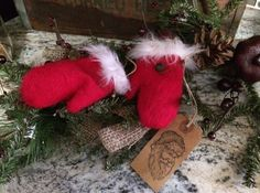 Tiny little Christmas mittens I made and displayed on garland. Made by Anita Jolls