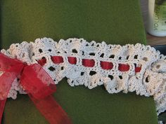 Ravelry: Springtime Lace Garter pattern by Amy Jajliardo.  Could also use for choker or headband.