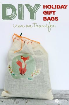 Easy DIY Holiday Gift Bags with GraphicStock| Iron Transfer canvas cotton bags makes gift wrapping easy! Fill with candy, gift cards, homemade gifts and you're done! See tutorial on TodaysCreativeLife.com