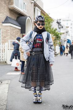 13-year-old Moeka on the street in Harajuku wearing a bomber jacket over a Listen Flavor top, layered sheer skirts from i tokyo me and Glad News, and metallic wedge sandals with socks.