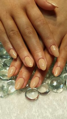 Nude almond shaped gel nails