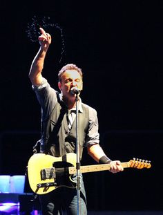 """Sweat flies off the arm of Bruce Springsteen as he and the E Street Band perform """"Adam Raised a Cain"""" at at Citizen's Bank Park. (Charles Fox / Staff Photographer)"""