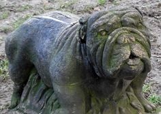 Dan was Dr George Sinclair's bulldog.  Sinclair, the organist at Hereford Cathedral, was a friend of Elgar's and dedicatee of variation XI of his Enigma Variations. Elgar reproduces Dan's bark in this piece. This carving of Dan stands, still barking, on the bank of the Wye in Hereford where he swam and scrambled back up the bank. Ruff! Philip Weaver