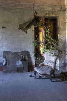 Chair left behind in an abandoned villa