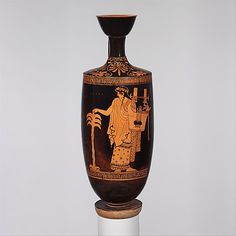 Terracotta lekythos (oil flask)  Attributed to the Nikon Painter     Period:      Classical  Date:      ca. 460–450 B.C.  Culture:      Greek, Attic