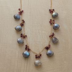 TO THE NINES NECKLACE�--�Labradorite briolettes, each crowned with a bubbly cluster of garnets, are evenly spaced along a delicate 14kt goldfilled chain. Handcrafted Sundance exclusive