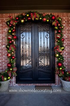 Show Stopping Christmas garland over your doorway to greet your guests.  www.showmedecorating.com