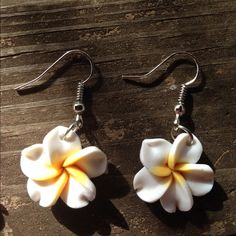 Hawaiian flower earrings Show a little tropical flair with these cute plumeria earrings. They are handmade from clay and the wire is silver plated. The flowers are roughly the size of a penny. Perfect for spring and summer! Check out my closet for more colors and other coordinating jewelry! Jewelry Earrings