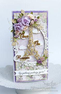 Male fantazje Oli, Card with oval frame, Eiffel Tower, flowers