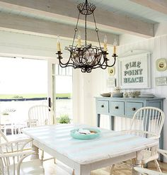 Couldn't you get used to eating at this precious shabby chic table while watching the waves crash?