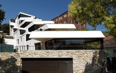 Built by Luigi Rosselli Architects in , Australia with date 2011. Images by Justin Alexander. The newly completed Benelong Crescent apartments are inspired by the sinuous forms of Erich Mendelsohn's Einstein Tow...