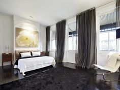 Curtains from the ceiling to the floor. White walls, dark carpet and white bedding. Oversized image above bed. Dark Curtains, Colorful Curtains, Bedroom Curtains, Home Decor Kitchen, Home Decor Bedroom, Bedroom Ideas, Carpet Decor, Carpet Ideas, Brown Furniture